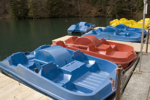 Blue, red, and yellow pedal boats